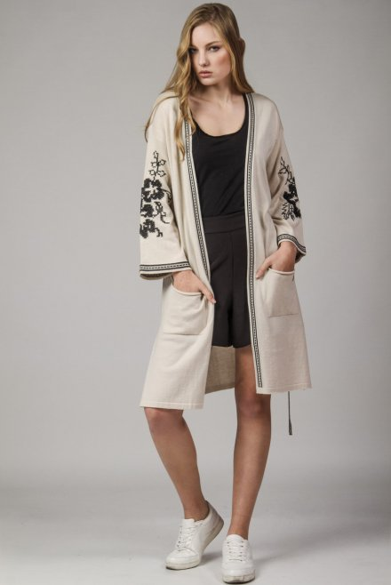Cardigan with a jacquard belt and a flower pattern at the sleeves beige-black