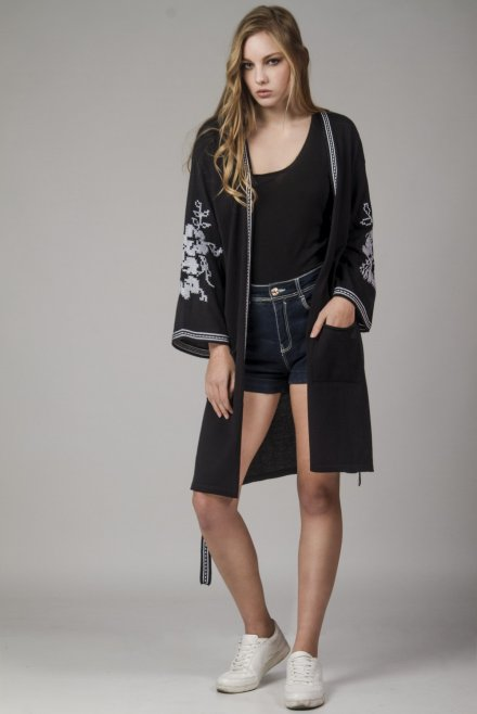 Cardigan with a jacquard belt and a flower pattern at the sleeves black-white